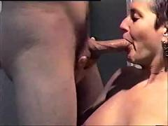 Short haired milf gives blowjob