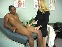 Blonde milf stroking cock in a doctors office for an experience