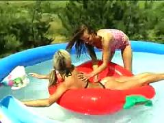 Giggly bikini teens in the pool teen young