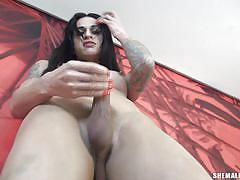 Super hot tranny strokes her thick cock
