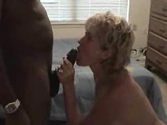Large blonde mom and a small black guy