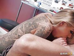 Naughty blonde tattoo artist blows her customer