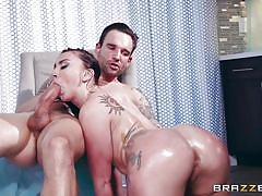 Oiled babe with round ass gives a footjob