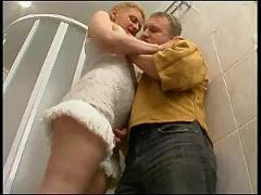 Russian mature fucked by a young boy in the shower