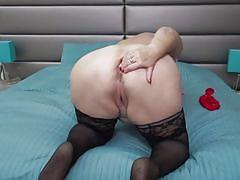 Old mature plays with her pussy