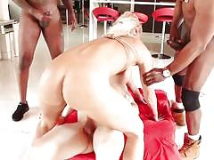 Interracial double penetration for the busty blonde