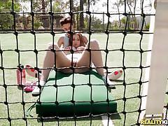 Sexy brunette masturbates on the court