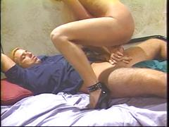 Blonde mature rides young stud and takes load on tits