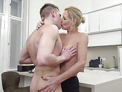 Kitchen sex with busty mature