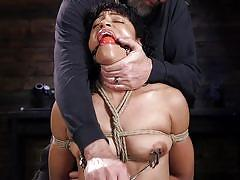 Naughty black haired babe getting punished by her master