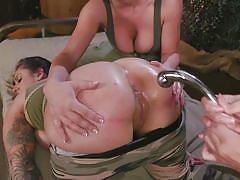 Big tit lesbians having an anal threesome