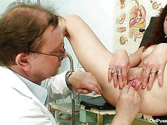 Brunette mature with tight vagina at her gynecologist