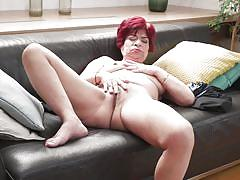 Redhead mature masturbates and fingers her asshole just for you