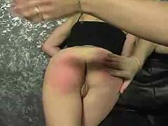 Two teen babes kissing and getting spanked in threesome