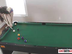 Two sexy brunettes play a game of strip billiards