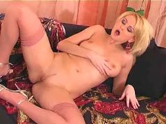 Milf masturbates in stockings