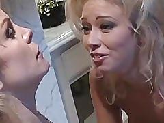 Two busty women go at it.