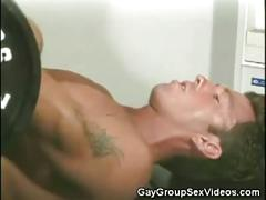 Horny jocks enjoys threesome anal in gym.