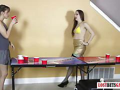 Two beautiful girls play strip beer pong