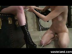 Busty femdom trains female sex slave with bondage games, toys and machines