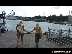 Two nasty blondes suck dudes cock all naked on seas shore