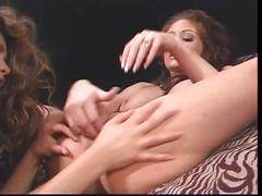 Lesbians stretching their pussies with dildos