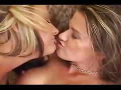 Lesbians using large dildo on each other