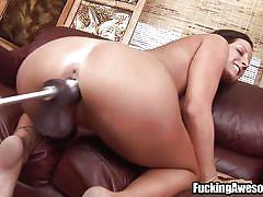 A big black dildo deep in her ass