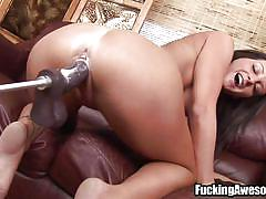 A big black dildo deep in her ass