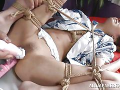 Tied up and has sex toys used on her