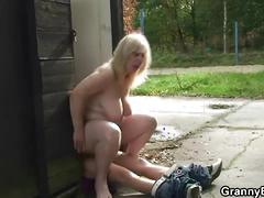 Big titted mature blonde rides a young dude's cock