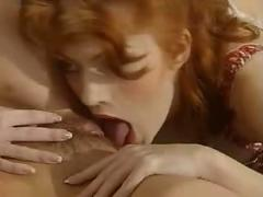 German redhead babe fist's a brunette babe
