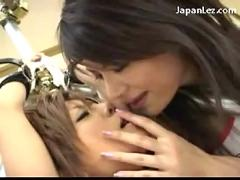 Pretty asian girl with tied arms squirting while getting her pussy licked fingered by 3 girls