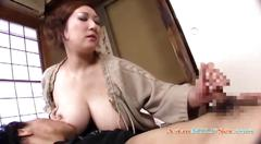 Busty asian milf loves to jerk his dick off