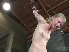 Blonde tortured in a dungeon