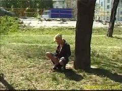 Nasty blonde pissing outdoor