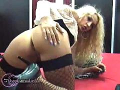 Small titted blonde milf in stockings and heels fingers and dildos her pussy