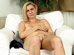 Mature lady masturbates slowly