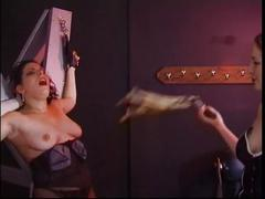Cruel dominatrix pinches and bites shackled slut's nipples