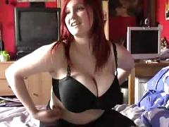 Huge titted redhead masturbating on her bed
