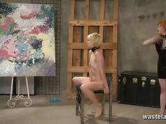 Redhead dominatrix whipping her blonde sub slave