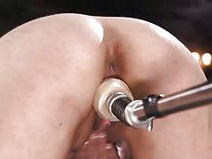 Naughty brunette babe penetrated by a fucking machine