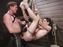 Suspended, dominated and fucked by muscular stud