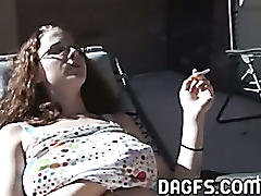 Smoking hot chick touches herself outside
