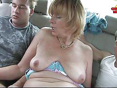 Blonde mature lady getting double blowjob