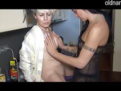 Granny and girl fucking in the kitchen