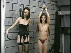 Slave gets bound by rope and mistress grabs her throat with her hands