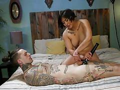 Busty asian mistress dominating a tattooed man