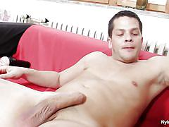 Horny guy masturbating on the couch
