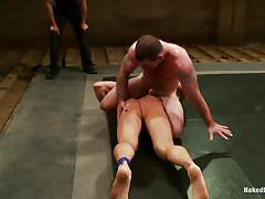 Wrestling between two naked muscled guys